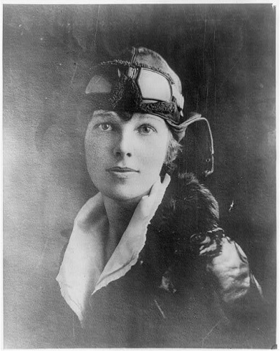 A photo of a very handsome Amelia Earhart in a leather pilot's hat and goggles