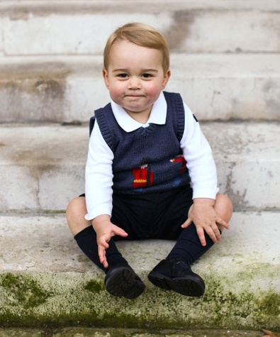 A photo of Prince George of Britain, a pudgy type in a blue sweater