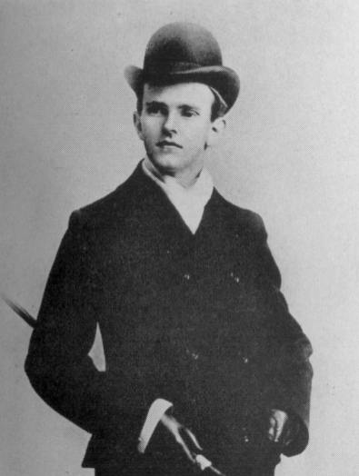 A photo of Calvin Coolidge, looking jaunty, in a suit and bowler hat
