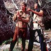 Photo of Fess Parker and Ed Ames in frontier and Native American garb, pointing