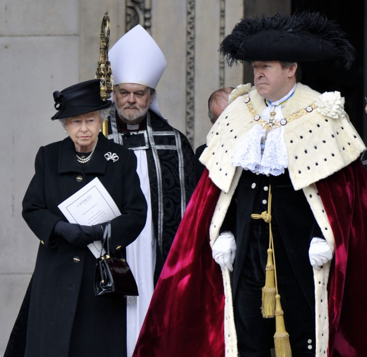 Photo of Queen Elizabeth with some kind of berobed grandee, plus a minister