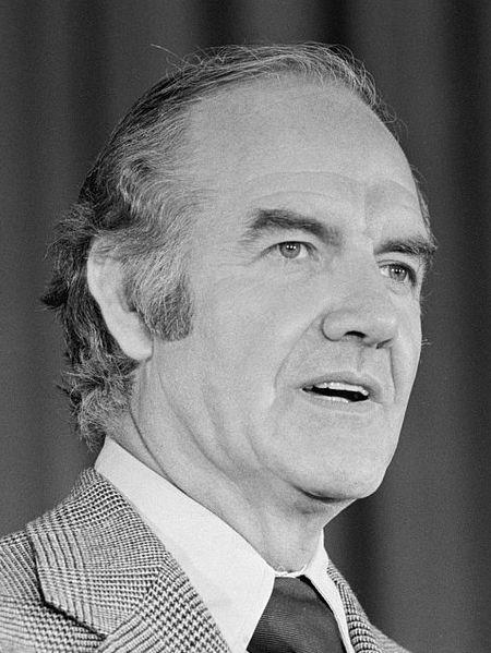 Photo of George McGovern in a houndstooth sport coat and longish 70s-style hair