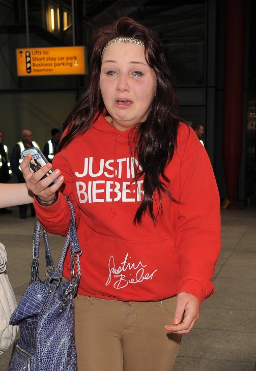 Photo of a Justin Bieber fan, same one as above, bawling in, uh, ecstasy or hysteria.