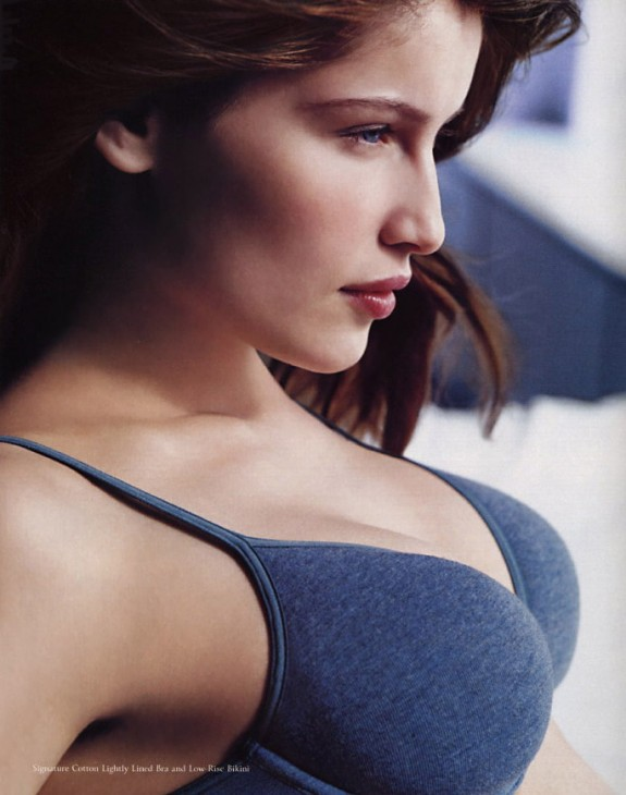 Photo of Laetitia Casta in a Victoria's Secret catalog, wearing a blue bra with her chest rather jutting out to the right