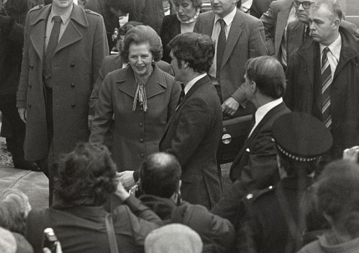 Photo of Margaret Thatcher in a crowd of admirers, outside, smiling