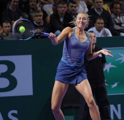 Photo of Maria Sharapova whacking a ball from the baseline