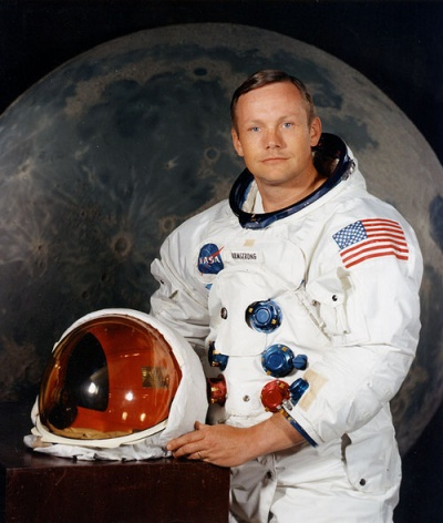 Neil Armstrong poses for a formal photo in his spacesuit