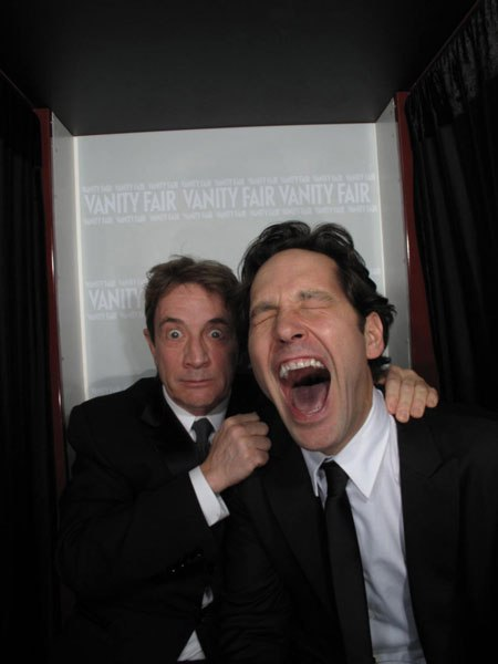 Photo: Paul Rudd laughs with mouth wide open as Martin Short mugs in the background