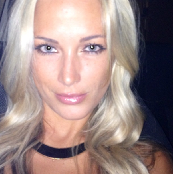 A photo of a blonde, blue-eyed Reeva Steenkamp smiling for a snapshot