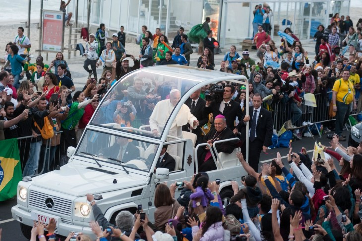 Pope Francis photo in his popemobile, with Brazilian crowds reaching out towards the car